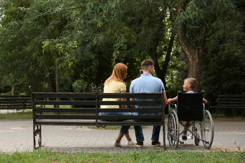 Boy in wheelchair with his family royalty free stock photos
