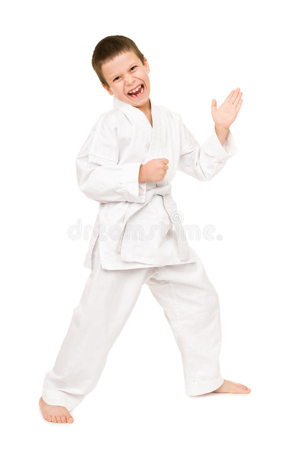 Boy in white kimono. For martial arts posing stock photo