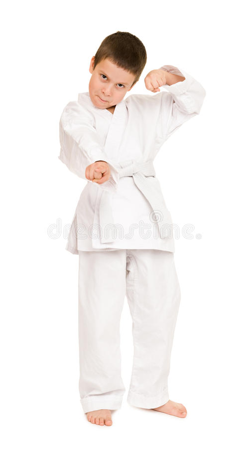 Boy in white kimono. For martial arts posing stock images