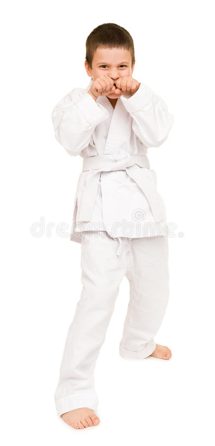 Boy in white kimono. For martial arts posing stock photos