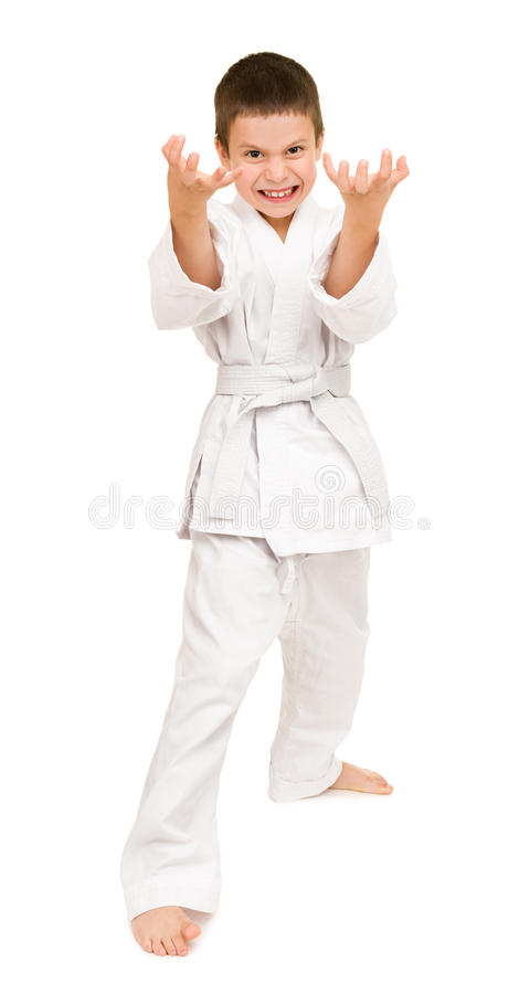 Boy in white kimono. For martial arts posing royalty free stock photography