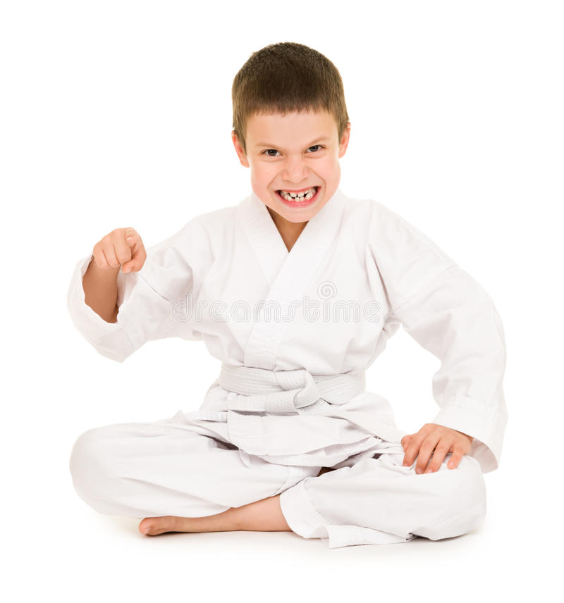 Boy in white kimono. For martial arts posing royalty free stock image