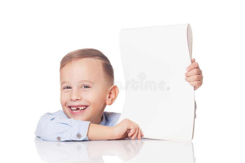 Boy with the white paper. Smiling young boy with blank paper on isolated white stock image
