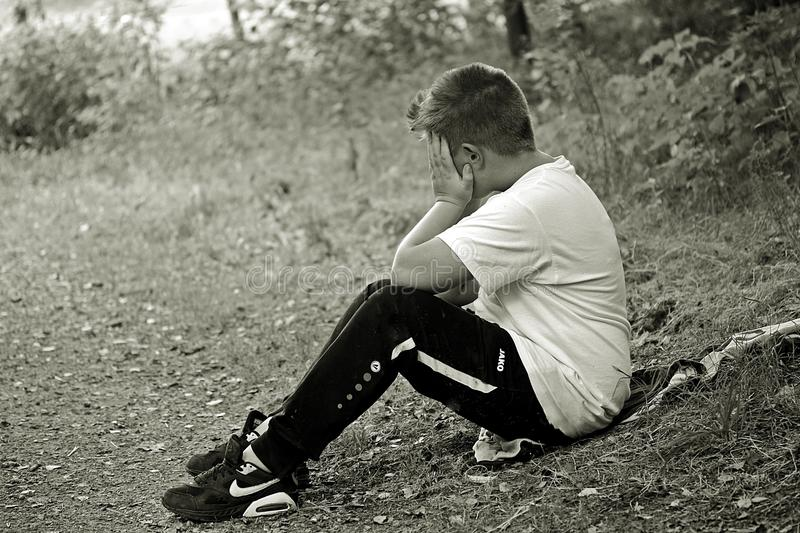 Boy in White Shirt and Black Track Pants stock images