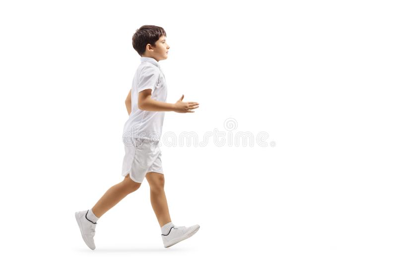 Boy in white shorts and t-shirt running royalty free stock photography