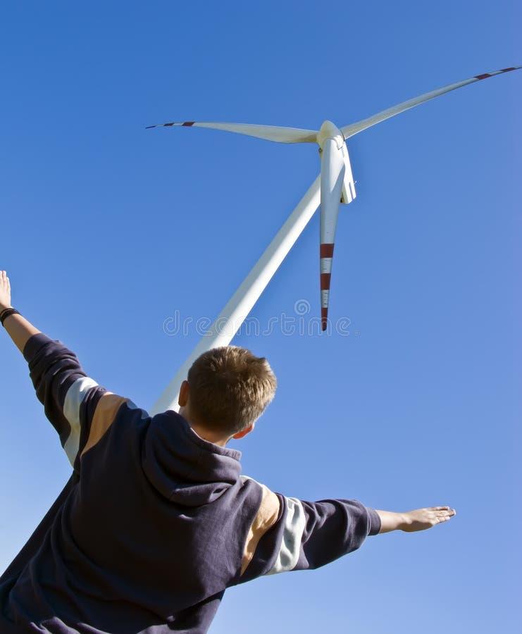 Download Boy and wind turbine stock image. Image of explore, imitating - 5474565