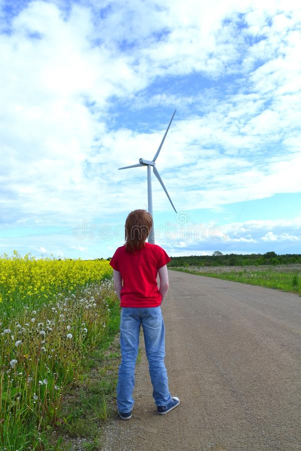 Download Boy and windmill stock photo. Image of colza, landscape - 25119658