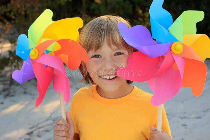 Boy with windmill toys royalty free stock image