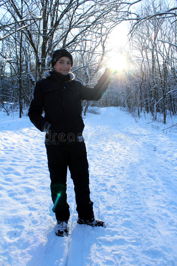 Boy in winter forest royalty free stock photo