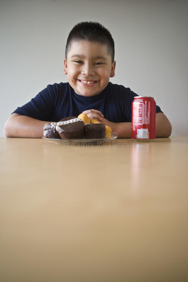 Free Boy With Dessert And Drink Sitting At Desk Royalty Free Stock Image - 29665446