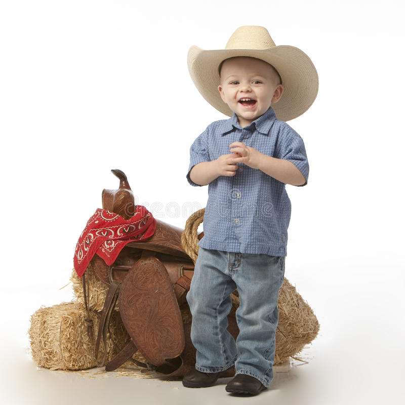 Free Boy With Hat And Saddle Royalty Free Stock Photo - 9363865