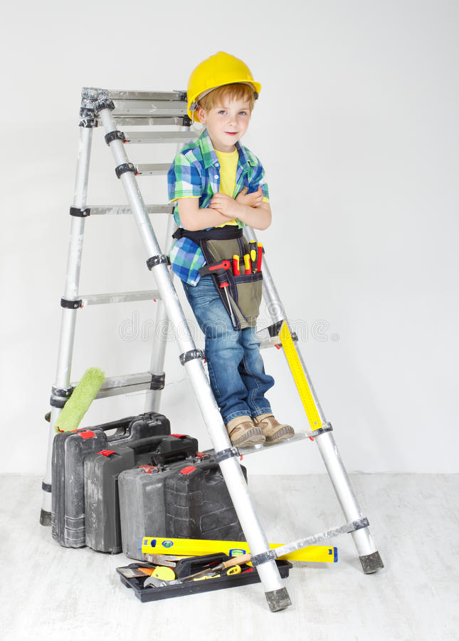 Free Boy With Helmet And Tool Belt On Stepladder Stock Images - 25269444