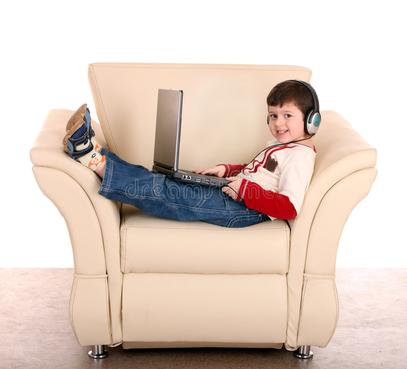 Free Boy With Laptop And Headphone. Royalty Free Stock Images - 8511979