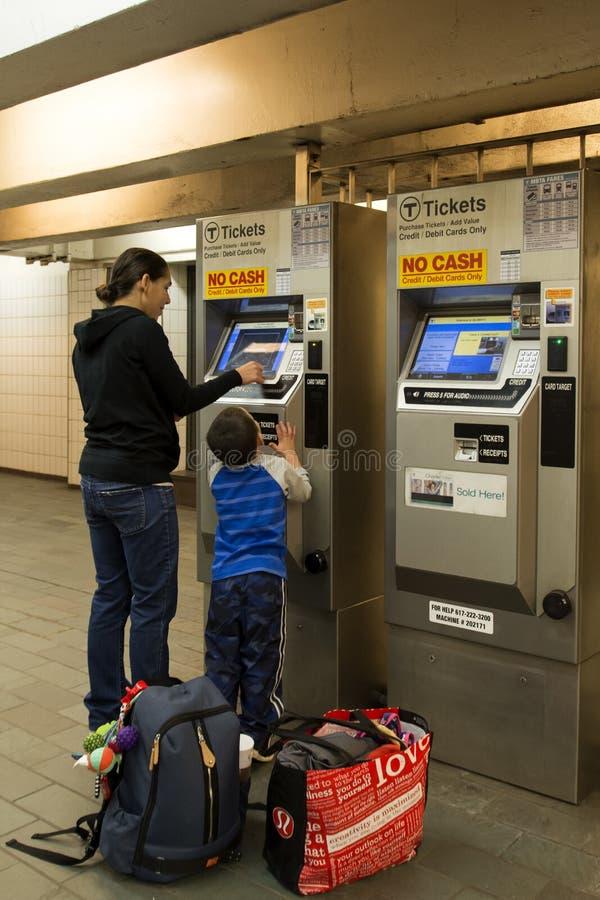 Boy and woman buyng tickets at Subway stock photos