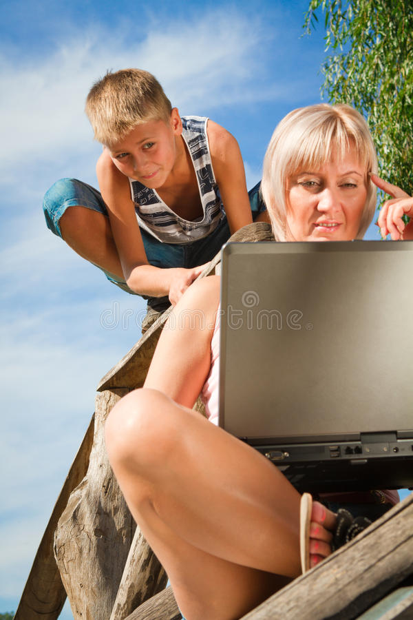 Download Boy and woman with laptop stock image. Image of computer - 28001023