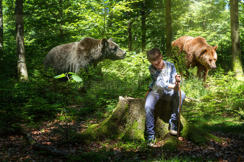 Boy in the woods with the bears. The abstract image of a boy in the woods with the bears stock image