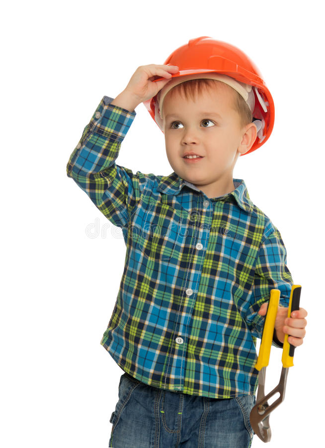 The boy wore on his head a hard hat royalty free stock images