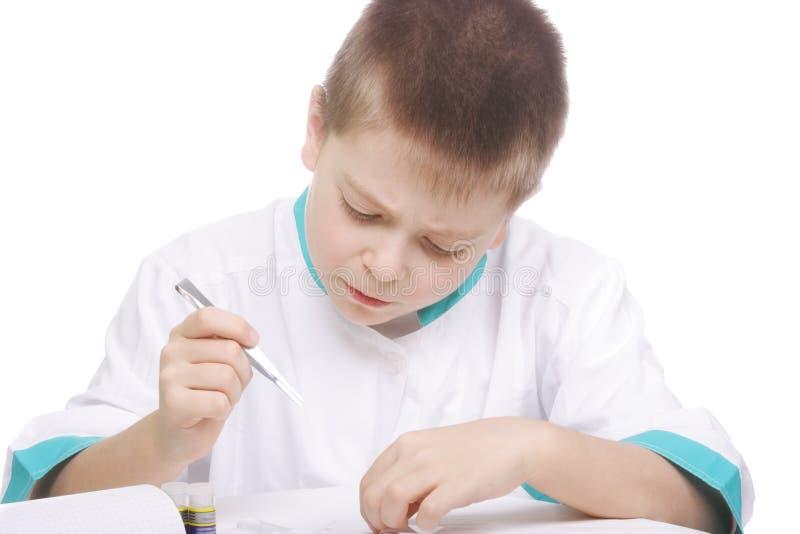 Boy working with tweezers