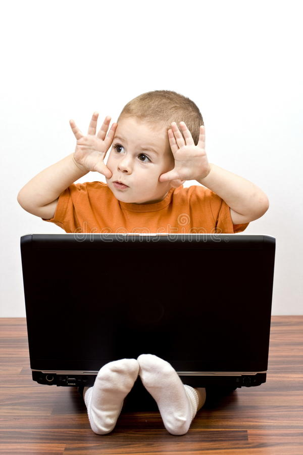 Boy working whit laptop royalty free stock images