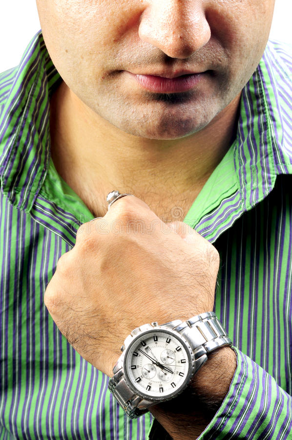 Boy with wrist watch. Indian boy with branded wrist watch stock photo