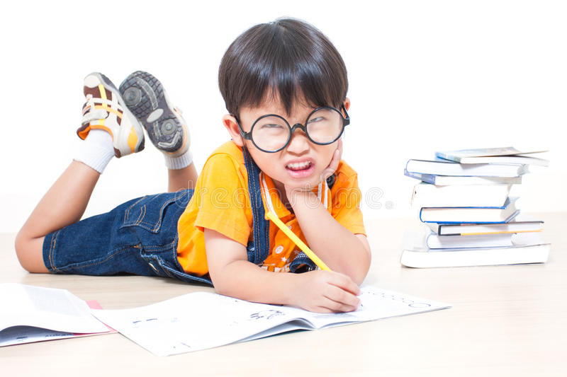 The boy writing homework. From school in workbook stock image