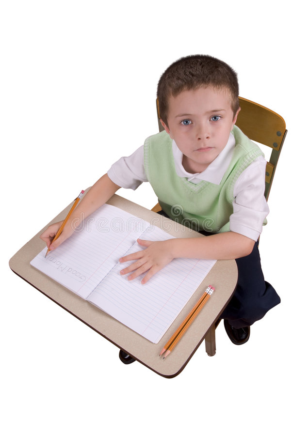 Download Boy Writting At School Desk Stock Image - Image: 3047975