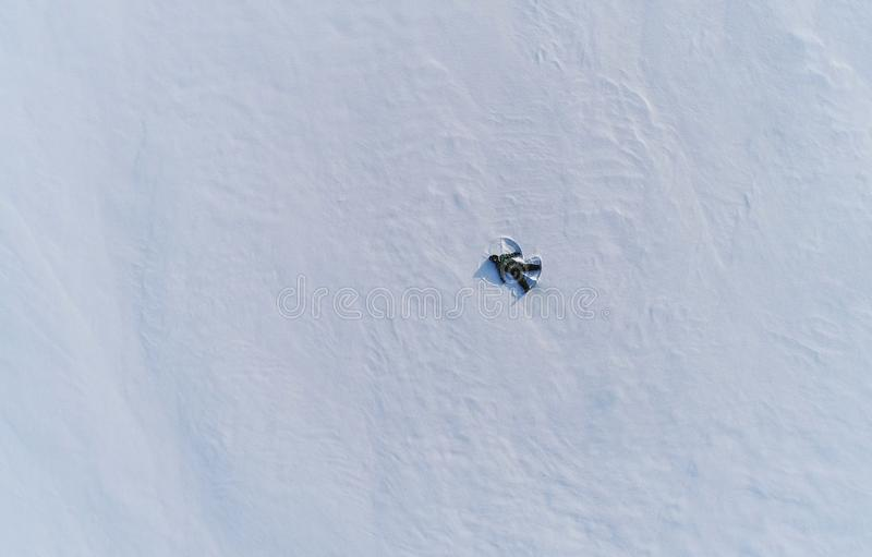 Boy of 7 years makes snow angel in snow area. Aerial foto. Boy of 7 years makes snow angel in snow area royalty free stock image