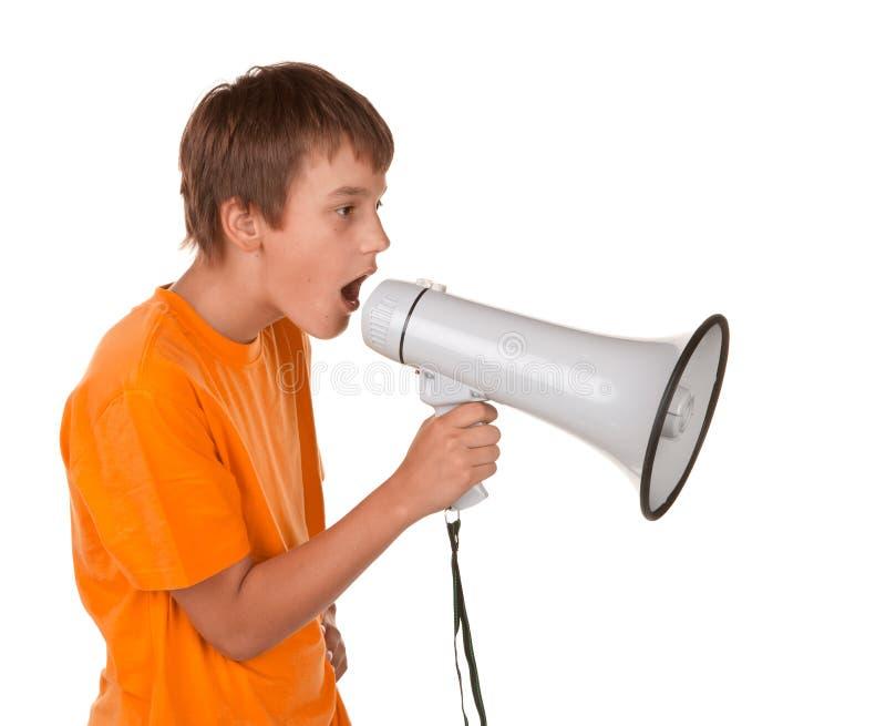Boy yelling into a megaphone stock photos