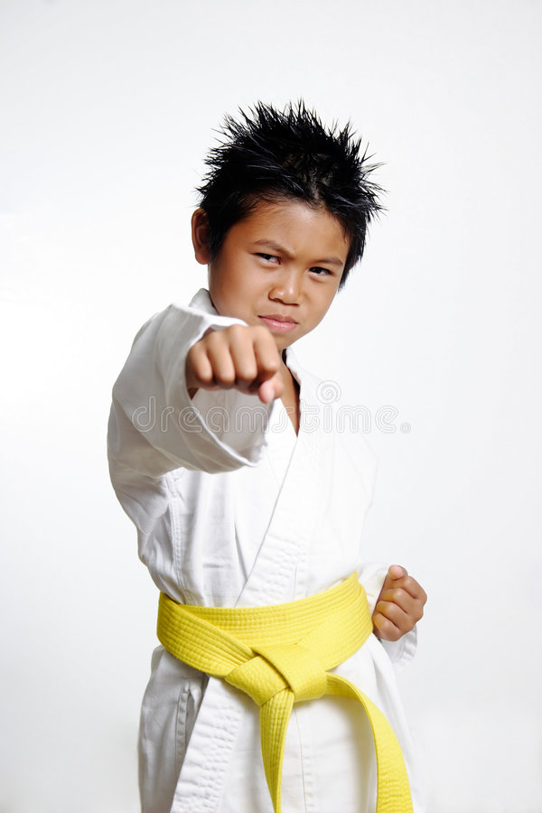 Boy with yellow belt Practicing royalty free stock photos
