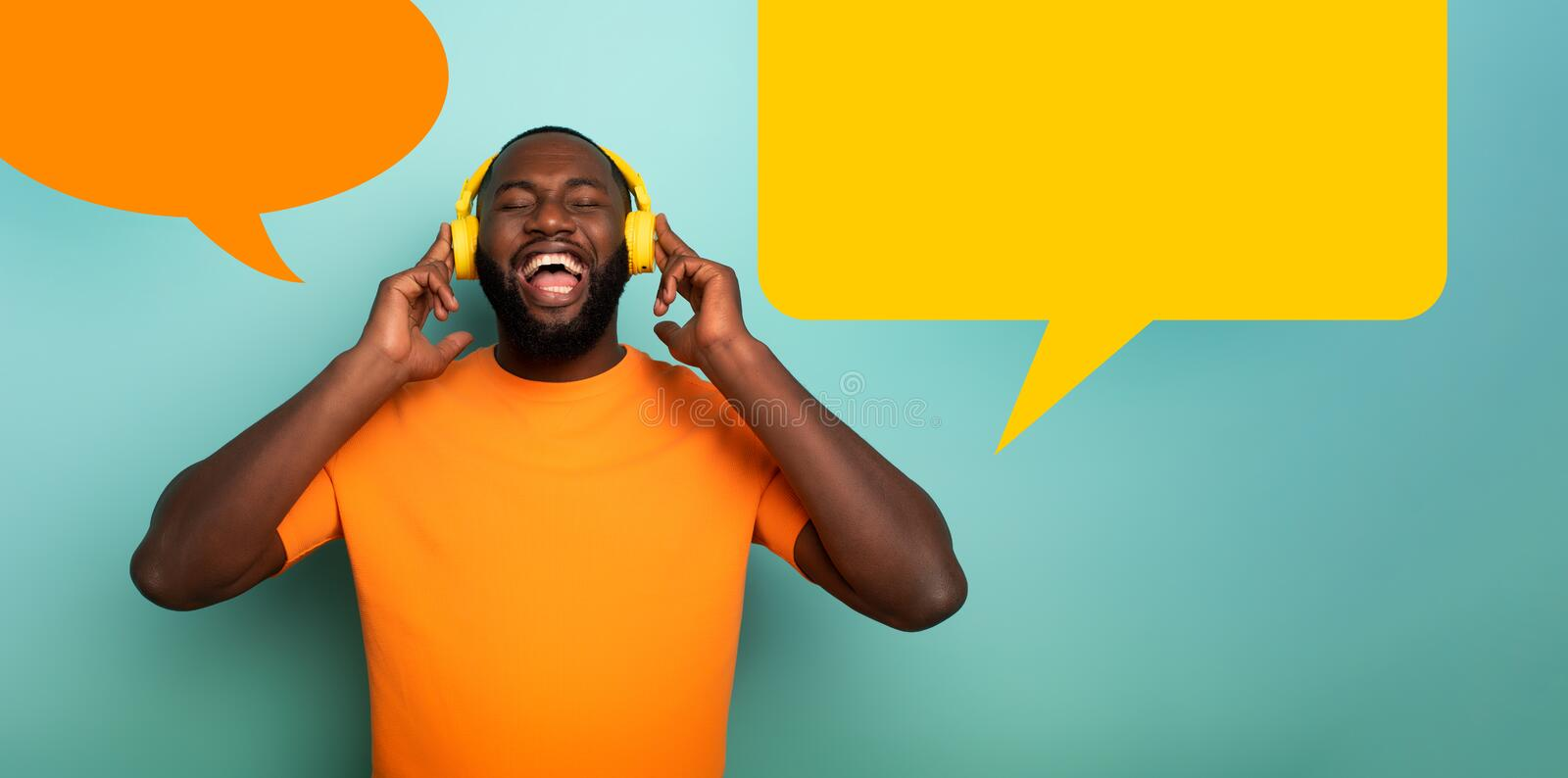 Boy with yellow headset listens to music and dances. emotional and energetic expression. vignette for your text. Black Boy with yellow headset listens to music stock images