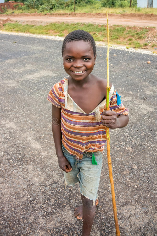 Boy in Zambia. Nyimba, Zambia - April 1, 2015: Young boy on the road in Nyimba small village in Zambia stock photo