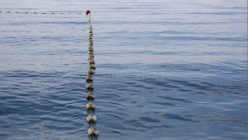 Boyas en el mar que rodean la zona de la natación fotos de archivo libres de regalías