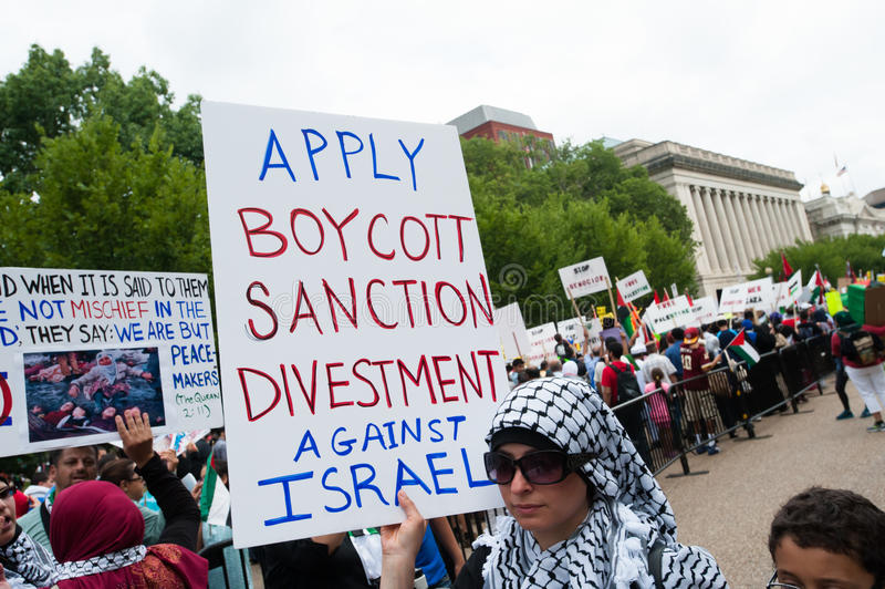 'Boycott Divestment Sanctions Against Israel' protest sign. Some 10,000 demonstrators march on the White House in Washington, D.C., to protest Israel's offensive stock image