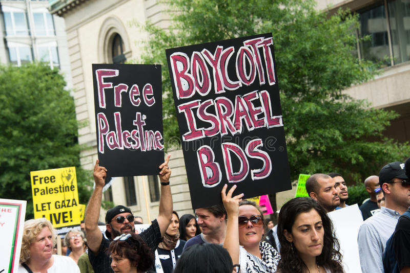 'Boycott Israel BDS' and 'Free Palestine' protest signs. Thousands march in Washington, D.C., to protest against U.S. support for Israel's offensive in Gaza royalty free stock photo