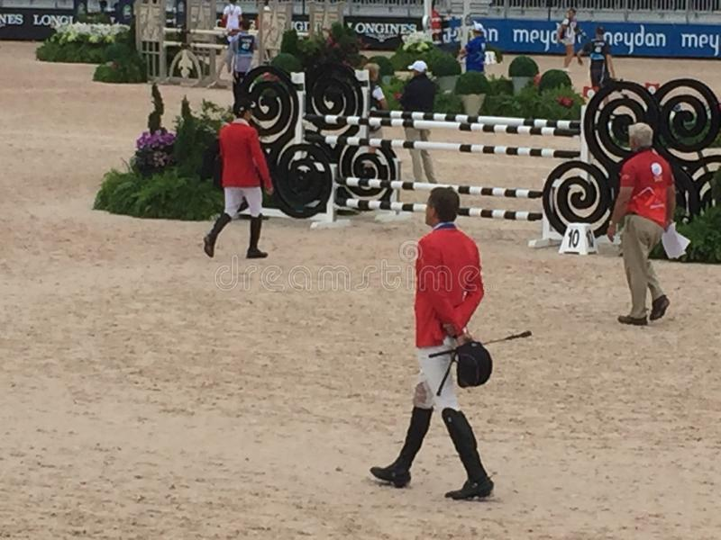 Boyd Martin team USA walking the show jump course 2018 world Equestrian games. After being postponed a day due to hurricane florance, Boyd Martin from the United royalty free stock photo