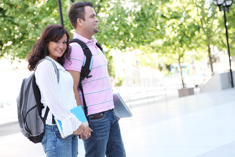 boyfriend and girlfriend at college stock photo - image of laptop