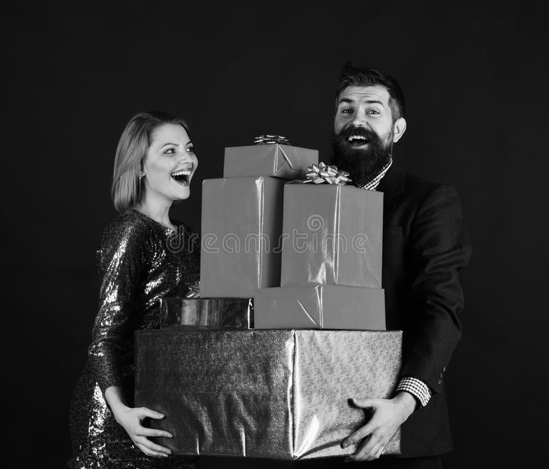 Boyfriend and girlfriend share gifts. Romance and celebration stock photography