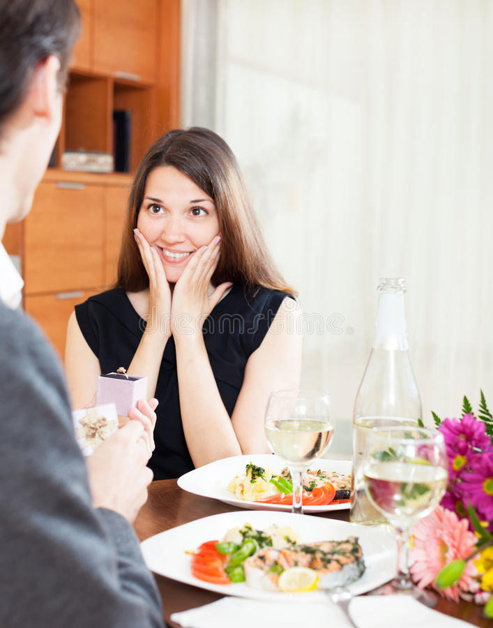 Boyfriend is giving an engagement ring to his girlfriend. During dinner stock images