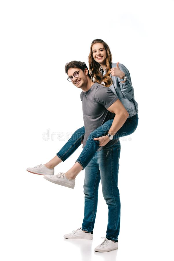 boyfriend giving piggyback to girlfriend and she showing thumb up royalty free stock photo