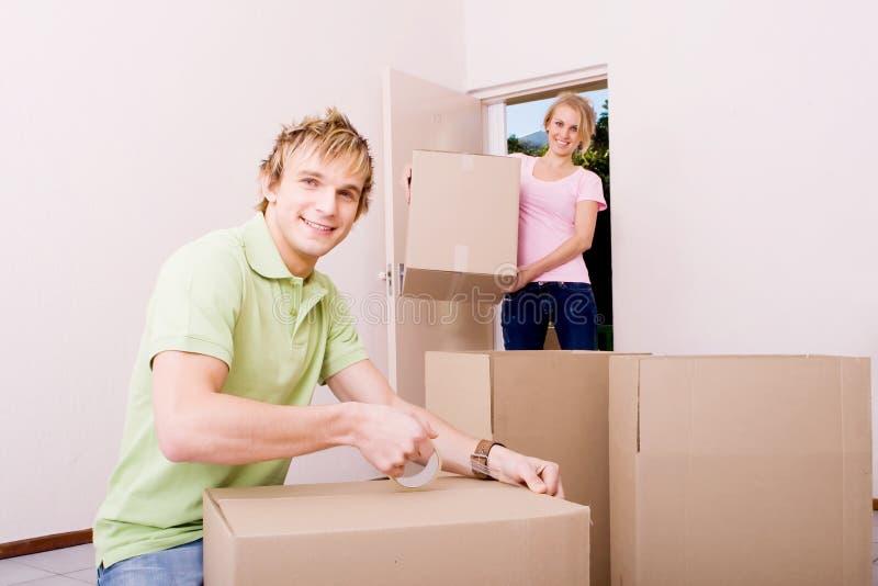 Boyfriend helping girlfriend move in royalty free stock photo