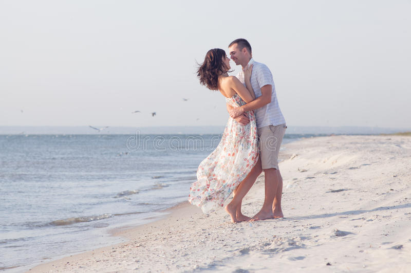 Boyfriend hugging his girlfriend stock images