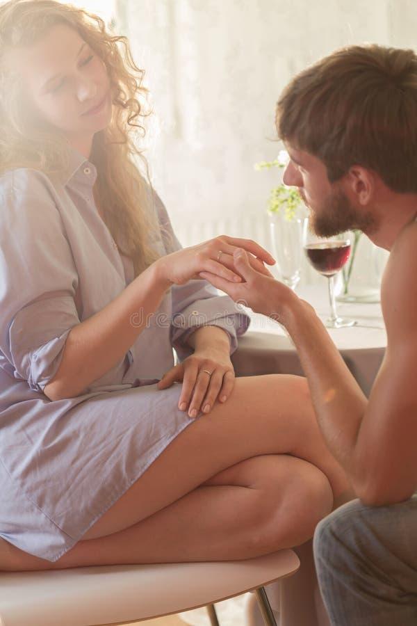 Boyfriend proposing to his girlfriend royalty free stock image