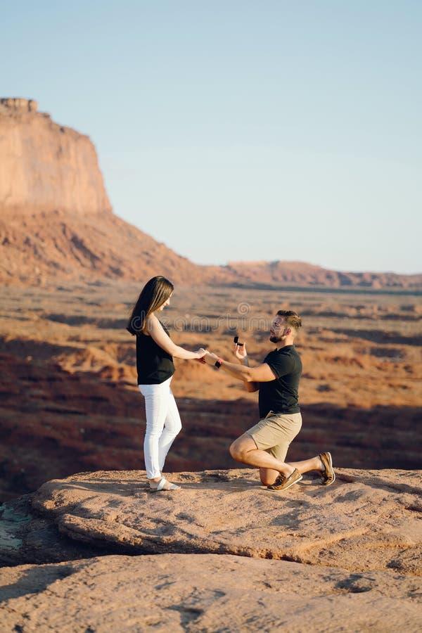 Boyfriend proposing to wife in Arizona. Boyfriend proposing to wife at monument valley in Arizona stock photos