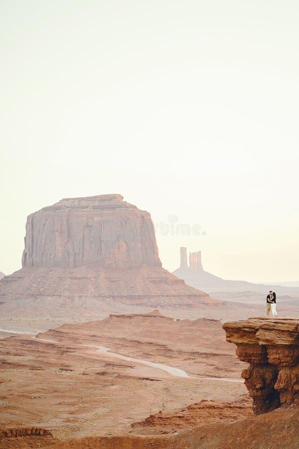 Boyfriend proposing to wife in Arizona. Boyfriend proposing to wife at monument valley in Arizona royalty free stock image