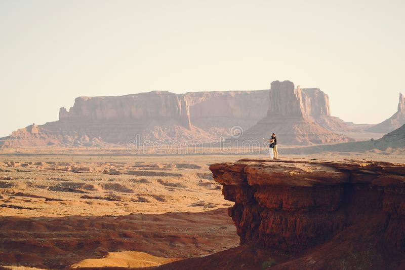 Boyfriend proposing to wife in Arizona. Boyfriend proposing to wife at monument valley in Arizona royalty free stock photos