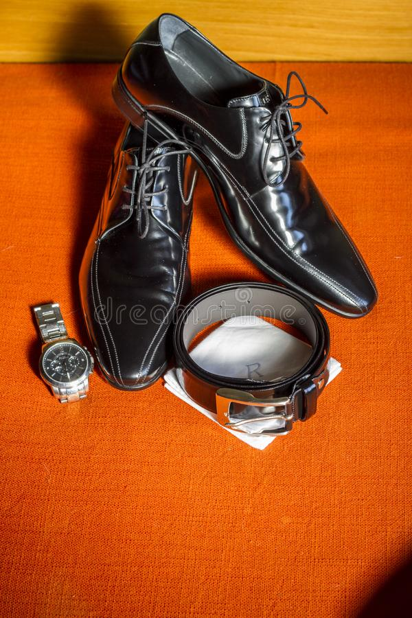 Boyfriend`s still life with shoes, belt stock photography