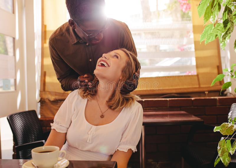 Boyfriend surprising his girl at cafe royalty free stock images