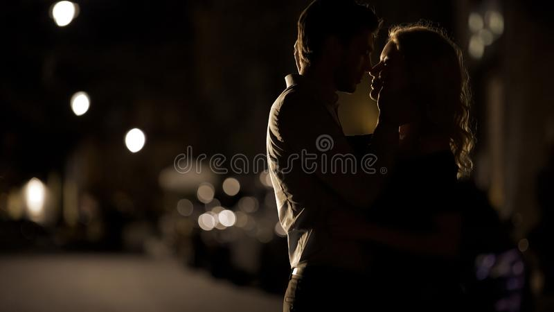 Boyfriend tenderly holding girlfriends face, romantic date, love relationship. Stock photo stock photo