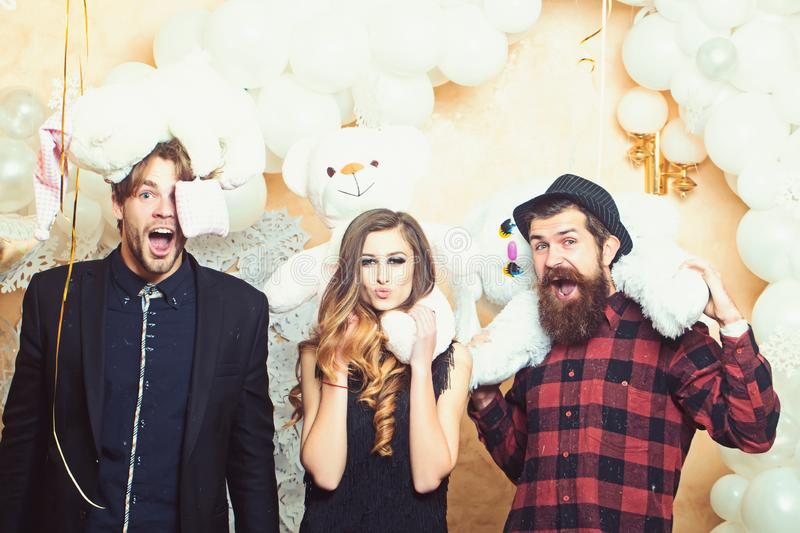 Boyfriends and girlfriend with teddy bear toys. Sensual woman and men lovers. Party or holiday celebration. Happy royalty free stock image
