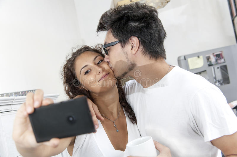 Boyfriends take a selfie at home. Just wake up stock photos